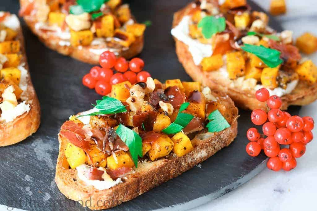 Fall Appetizer Roundup - Roasted Acorn Squash Crostini with Crispy Proscuitto and Goat Cheese from Dawn at Girl Heart Food