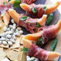 Prosciutto Wrapped Melon & Basil Cheese Board