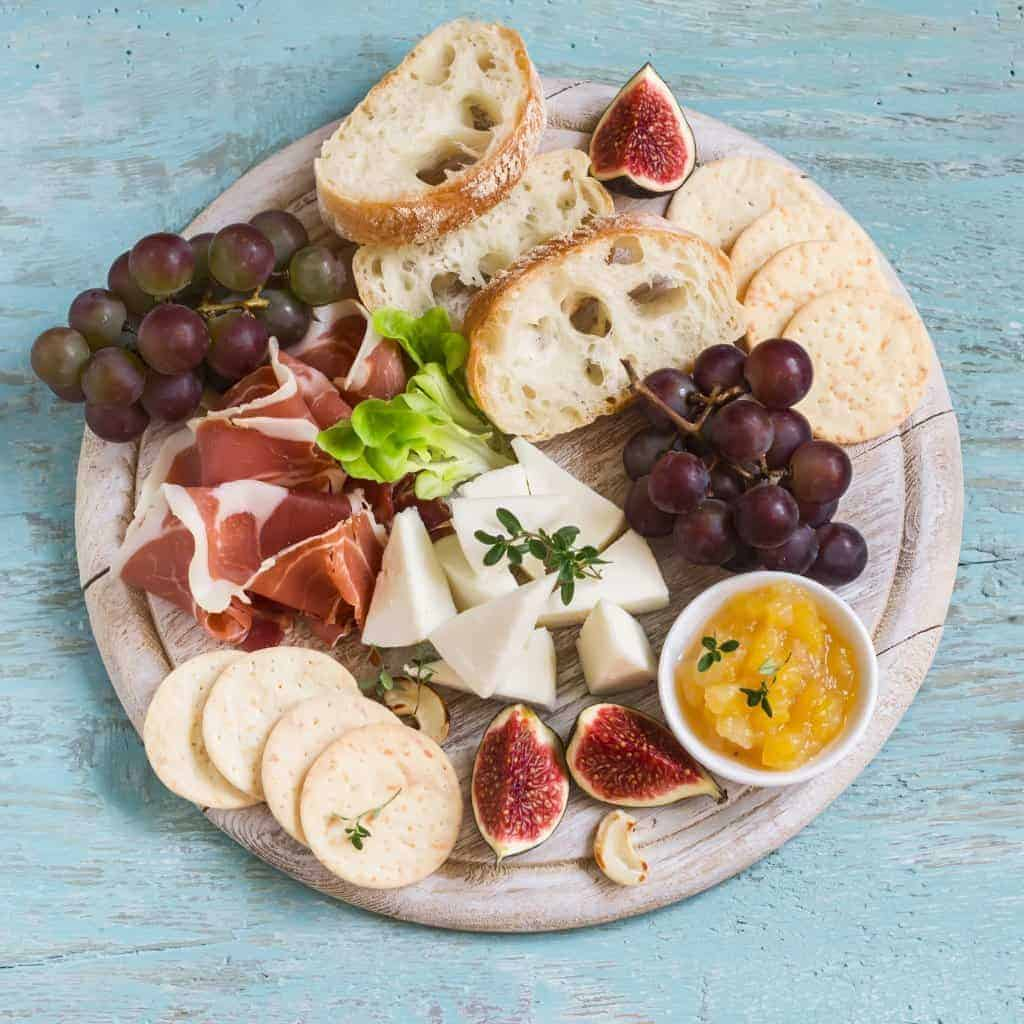 How to make a charcuterie board with meats and cheese.