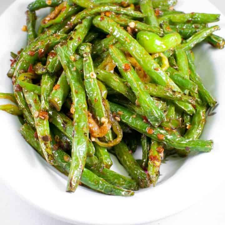 Recipe for sautéed green beans step by step.