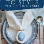 Egg wrapped in napkin made to look like bunny ears for spring table settting