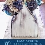 Blue flowers in a wooden toolbox for spring table setting