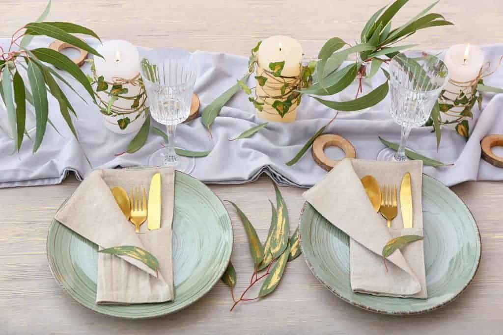 Spring Table Setting Idea: soft green plates with burlap napkins and gold flatware.  Candles wrapped in greens.