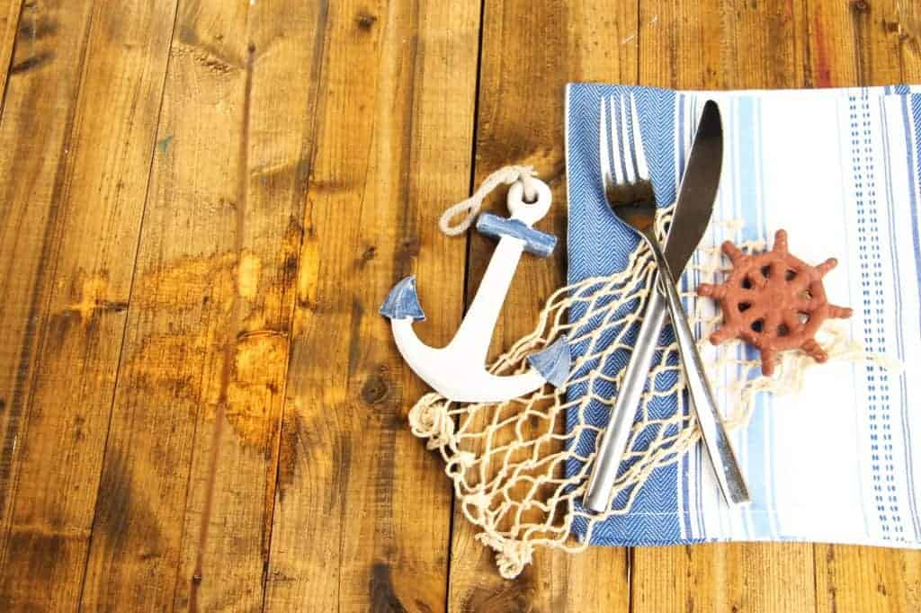 Nautical table setting decor ideas. Fishing net cut to size, anchor decor.