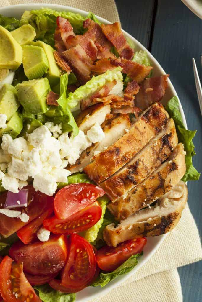 Traditional Cobb Salad including lettuce, grilled chicken, tomatoes, onions, blue cheese ,avocados and bacon.