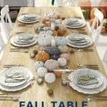 Pretty fall tablescape with different color pumpkins and white dishes