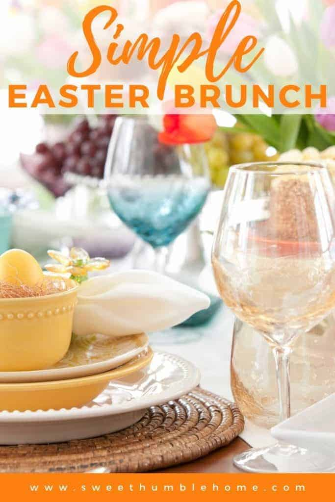 Brunch table set for an Easter Brunch with pastel dishes and glasses.