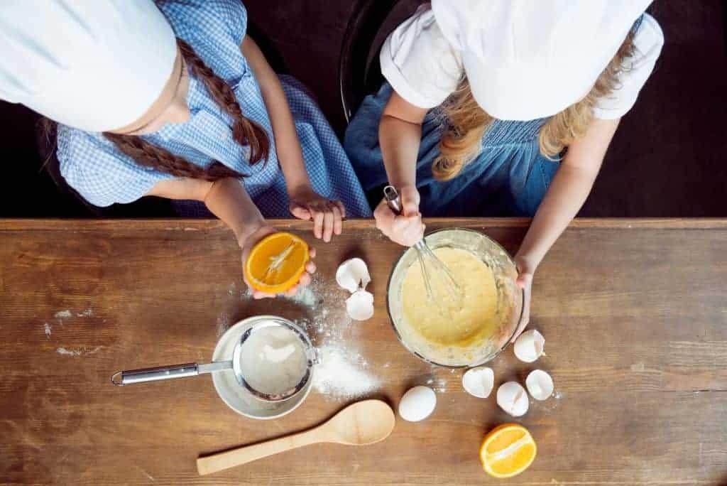 Kids preparing food to cook.